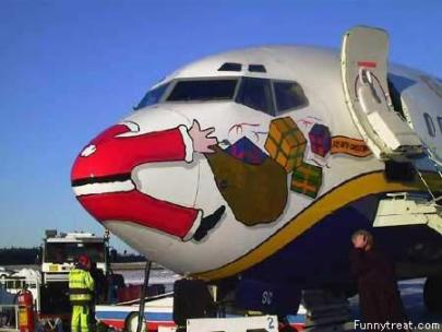 funny-christmas-photos-santa-on-the-nose-of-a-plane